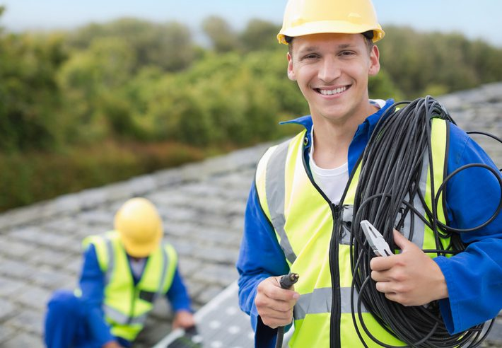 Gill Insurance | Worker smiling on rooftop