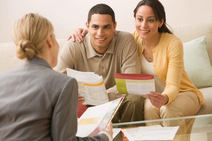 Gill Insurance   Hispanic couple receiving financial consultation